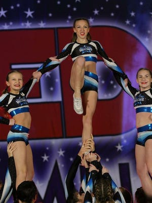 Members of the Oklahoma Outlaws Cheer team perform a stunt during the Redline Nationals competition which was held earlier this month in Oklahoma City.