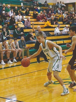 Matthew Shanline handles the ball for the Pratt Greenbacks last Tuesday against Hays.
