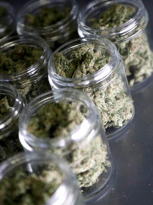 FILE- In this March 22, 2019 file photo, marijuana buds are seen in prescription bottles after being sorted at Compassionate Care Foundation's medical marijuana dispensary in Egg Harbor Township, N.J. Missouri voters in 2018 approved medical marijuana. As of Tuesday, five commercial growers and six dispensaries had passed inspections from the state health department to start growing and selling pot legally. The Missouri Department of Health and Senior Services administers the state's medical marijuana program.