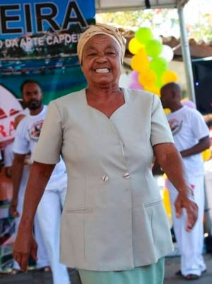 """This 2017 photo provided by Nally Oliveira Costa shows her mother Carivaldina Oliveira da Costa, or """"Aunt Uia"""" during a presentation of Capoeira, in Rasa quilombo Buzios, Brazil. The woman known as Tia Uia has often been described as a """"living library"""" - the keeper of the community's stories and customs who could recall the days before Buzios became an elite seaside getaway, and who fought for the rights of those living in quilombos. She died of COVID-19 last month, aged 78."""