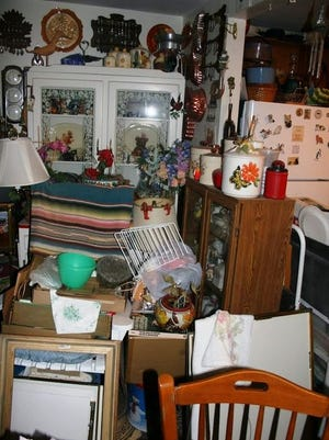 This cluttered room was found by public safety officials in a South Shore town in 2017.