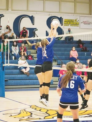 Ciara McDowell, No. 12, and Maddie Fields go up for the block, while Kirsten Hinzman, No. 16, covers.