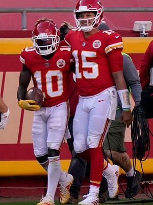 Kansas City Chiefs wide receiver Tyreek Hill (10) and quarterback Patrick Mahomes (15) celebrate after connecting on a touchdown pass against the Carolina Panthers during the second half of an NFL football game in Kansas City, Mo., Sunday, Nov. 8, 2020.