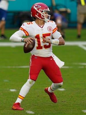 Kansas City Chiefs quarterback Patrick Mahomes (15) looks to pass the football, during the first half of an NFL football game against the Miami Dolphins, Sunday, Dec. 13, 2020, in Miami Gardens, Fla.