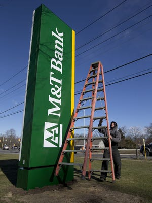 M&T Bank Corp. will pay $64 million to settle claims that it that didn't comply with underwriting and quality control requirements on some of its mortgages, the U.S. Justice Department said Friday. M&T Bank recently took over Hudson City Savings Bank, including this Toms River branch.