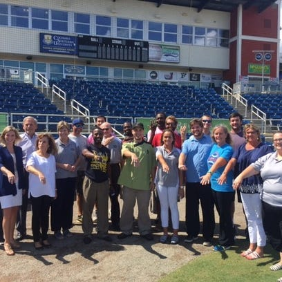 Members of the Pensacola Blue Wahoos front office and