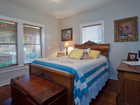 A guest room overlooks the front porch and is decorated