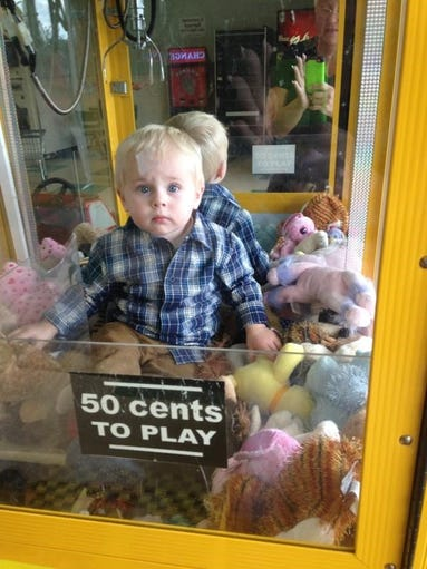 18 month old Stuck in toy machine...