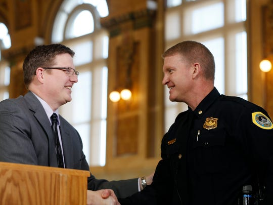 City Manager Scott Sanders (left) shakes hands with Maj. Dana Wingert Wednesday, Feb. 4, 2015, at city hall as Sanders introduces Wingert as his choice for the police chief.