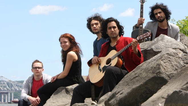 The BeStills, including Sherjan Ahmad (in red jacket with guitar), will perform at a unity concert in Nyack.