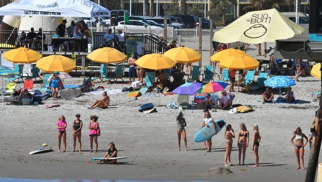 Sunday at the Salty Sweet Women's Pro-Am Surf Contest hosted by the Cocoa Beach Pier. The competition included kids and adults in several categories.