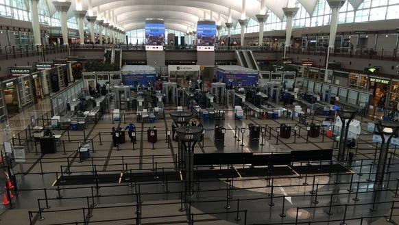 Security queues appear deserted at Denver International