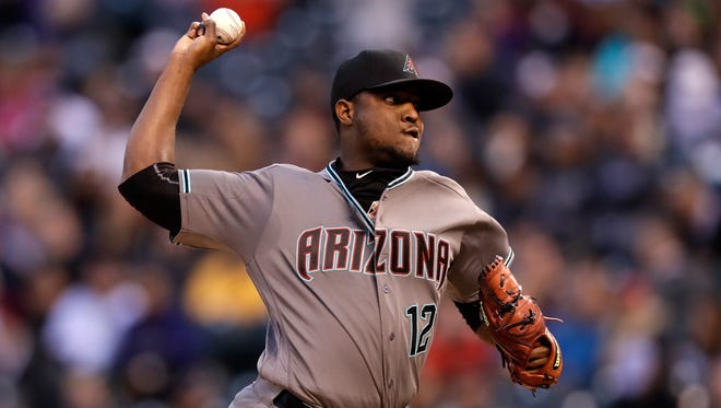 DENVER, CO - MAY 10:  Starting pitcher Rubby De La Rosa #12 of the Arizona Diamondbacks delivers against the Colorado Rockies as he earned the win at Coors Field on May 10, 2016 in Denver, Colorado. The Diamondbacks defeated the Rockies 5-1.