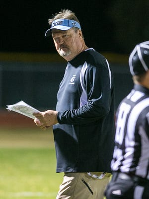 Glendale Cactus head coach Larry Fetkenhier at their high school football game against Queen Creek in Queen Creek on Friday, November 8, 2013.