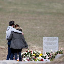 Relatives of the victims of the air crash visit the memorial in Le Vernet, south-eastern, France, on March 30, 2015.
