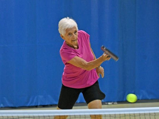 Kathy McNeal, a tennis player since high school, has also fallen in love with pickleball.