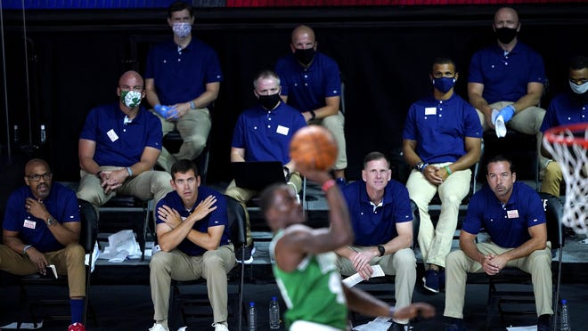Celtics head coach Brad Stevens, second from bottom left, and his coaching staff look on as Javonte Green goes up for a shot against the Toronto Raptors Friday in Lake Buena Vista, Fla.
