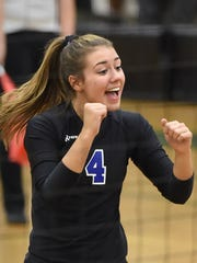 McQueen's Kaila Spevak celebrates a point during a game against Hug.
