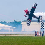 Prometheus cuts a ribbon with his wing Saturday afternoon during the Field of Flight air show.