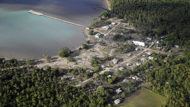 This Sept. 29, 2009 file photo captures an aerial view of Falehau in Tonga after a powerful quake in the South Pacific hurled massive tsunami waves at the shores of Samoa, American Samoa and Tonga. A 5.8-magnitude earthquake struck the kingdom Sunday, April 17, 2016.