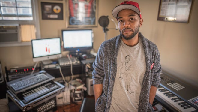 """Clemson University doctoral candidate A.D. Carson stands in his home studio near campus, Jan. 30, 2017. Carson used the studio to produce """"Owning My Masters: The Rhetorics of Rhymes and Revolutions"""", a 34-track rap album that also serves as his dissertation. (Photo by Ken Scar)"""