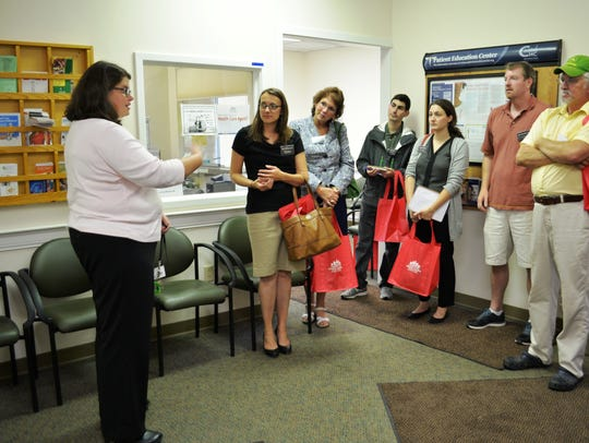 Erin Ahearn gives a tour of the Safe Harbor homeless health care center in 2015