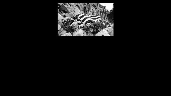 Maj. Howie's body atop the church rubble.