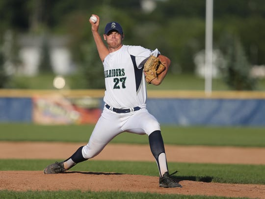 Victor Railriders pitcher Luke Tomcyzk delivers a pitch