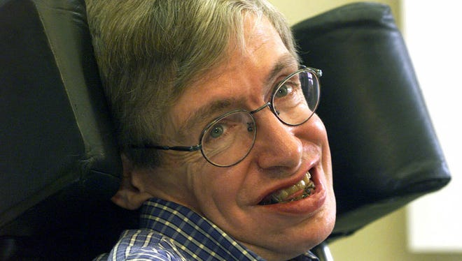 Stephen Hawking smiles during a news conference at the University of Potsdam, near Berlin, on July 21, 1999.