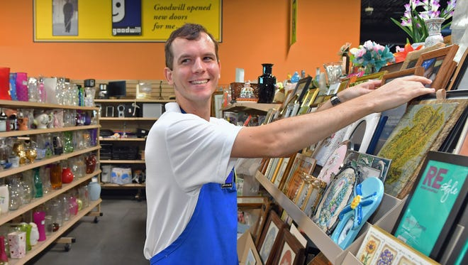 Floor clerk Andrew Howes, 26, is deaf and is part of the the workforce through the Goodwill job placement program, and enjoys his job at the West Melbourne store location.