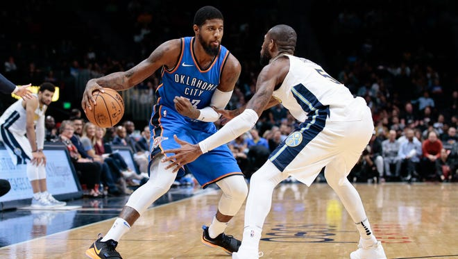 Denver Nuggets guard Will Barton (5) guards Oklahoma City Thunder forward Paul George (13) in the third quarter at the Pepsi Center.