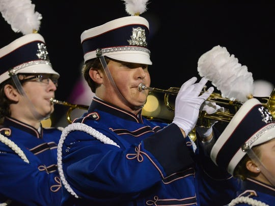 Scott Brickner plays trumpet during the halftime show at a St. Clair football game. Brickner, a 2015 SCHS graduate, will perform the National Anthem with a brass quintet Friday as part of the Detroit Tigers' home opener at Comerica Park.
