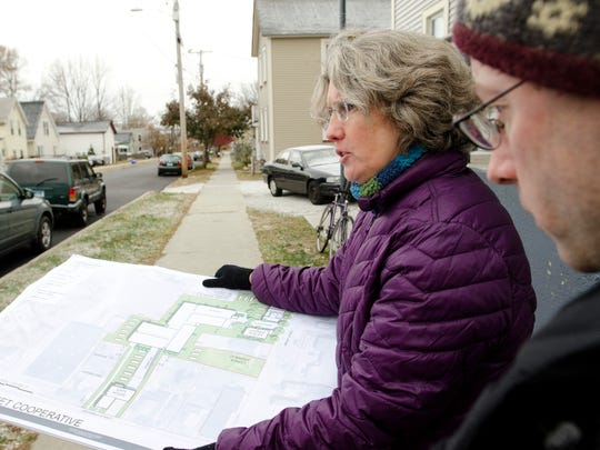 Chris Donnelly (right) and Amy Demetrowitz of Champlain Housing Trust tour Bright Street in Burlington's Old North End as they announce a new co-op housing development project in 2013.