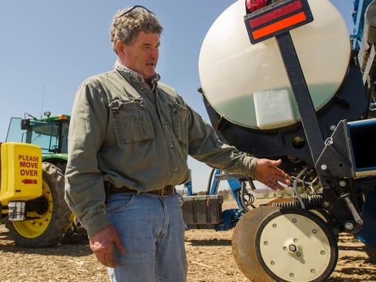 Alvin Ferguson talks about planting corn seed Sunday,