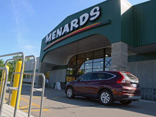 A vehicle passes the entrance to Menards Sunday, July 10, in Port Huron Township.