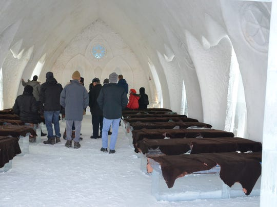Visitors admire the wedding chapel at Hotel de Glace in Quebec City, Canada.