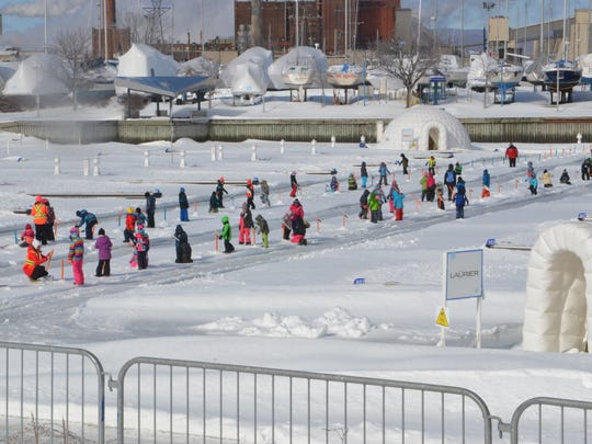 Children ice fishing in the Village Nordik in the Port of Quebec.
