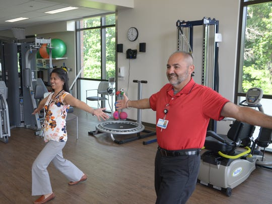 Physical therapist Arlene Buenvenida, left, and physical