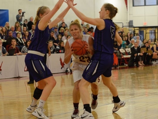 Salisbury's Sarah Seipp drives past two Amherst defenders.