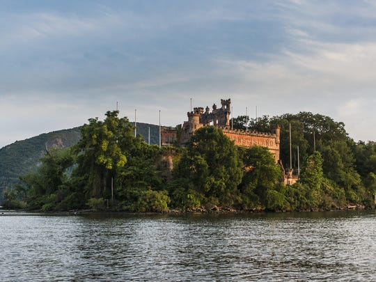 "The tall poles installed around Bannerman Castle as part of Melissa McGill's ""Constellation"" art installation are evident in this daytime view of Pollepel Island in the Hudson River in Beacon."