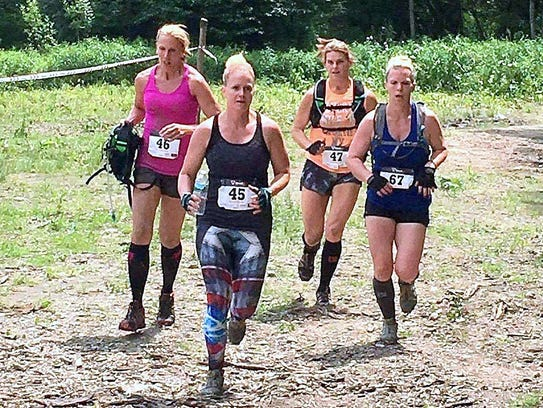 """Runners take part in the """"Dirty In Your Shirty"""" charity"""