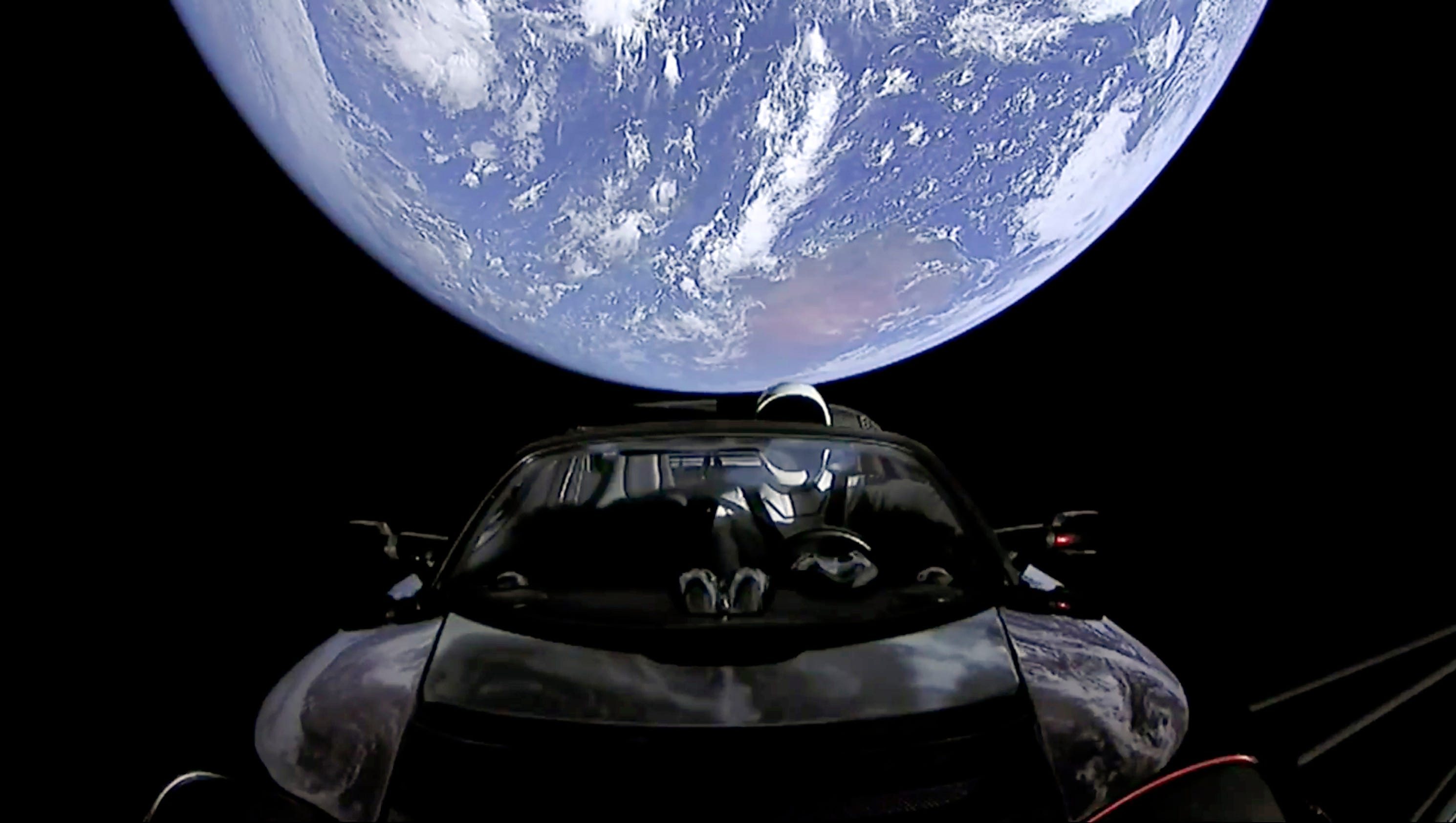 Elon musk shares last mage of 39 starman 39 cruising into for Jobs in outer space