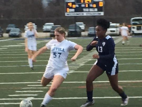 Loyola's Hope Davis fires a shot on goal against Lafayette