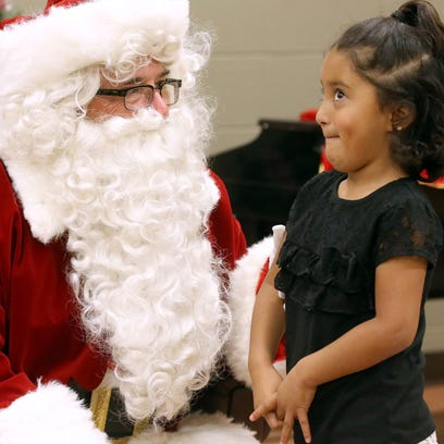 Zhoie Garza thinks of what she wants for Christmas