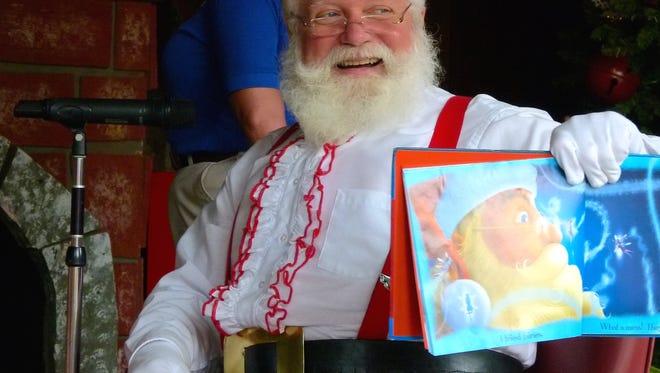 Santa Claus reads a Christmas story in Santa Claus, Indiana.