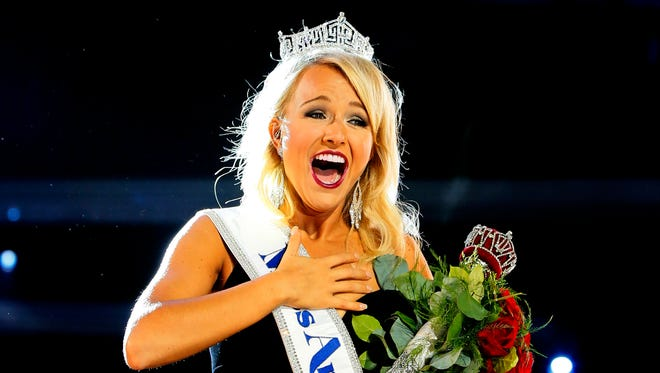 Miss Arkansa Savvy Shields waves to crowd after being named new the Miss America 2017, Sunday, Sept. 11, 2016, in Atlantic City, N.J.