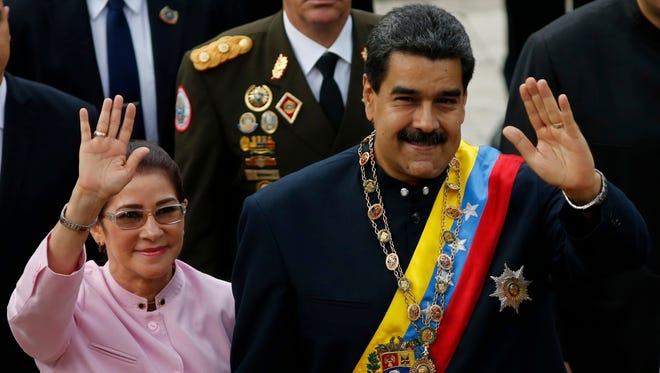 Venezuela's President Nicolas Maduro, right, and his wife Cilia Flores wave as they arrive to the National Assembly building for a session of the Constitutional Assembly in Caracas, Venezuela, on Aug. 10, 2017.