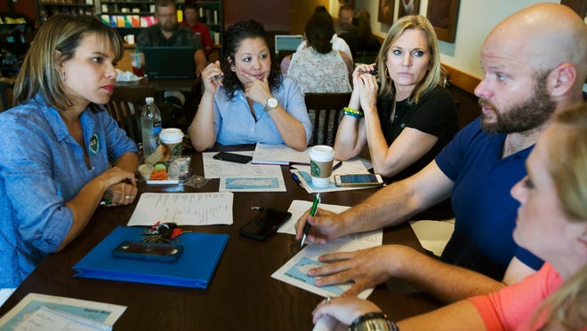 Claribel Bocanegra, left, Ivette Galarza, Rep. Heather Fitzenhagen, Andrew Kagan and Darla Bonk plan the delivery of supplies to Puerto Rico to help victims of Hurricane Maria during a brainstorming session on Sunday in south Fort Myers.