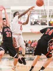 Northeastern's Fred Mulbah (11), passes the ball, during