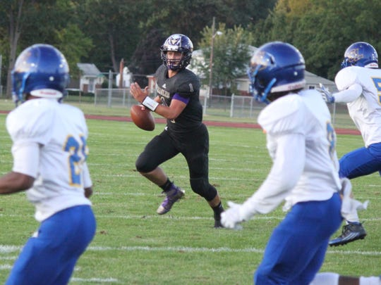 Madison Heights Madison junior quarterback Austin Brown ran for two touchdowns and threw for another in a 44-24 win over St. Clair Shores South Lake on Aug. 31, 2017.